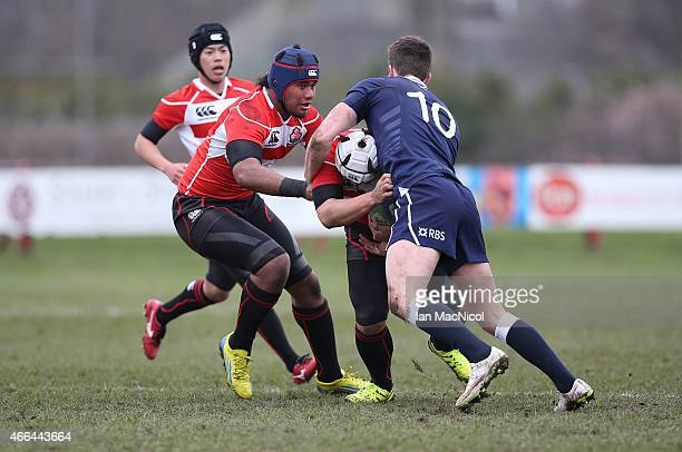 Ryo Hattori of Japan runs with the ball during the International Rugby Union Challenge Match between Scotland U19 and Japan Schools at Inverleith on...