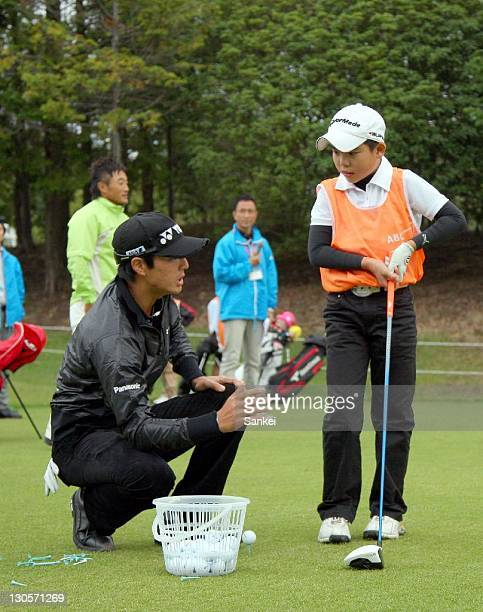Ryo Ishikawa coaches a boy during the junior lesson of the Mynavi ABC Championship official training at the ABC Golf Club on October 25 2011 in Kato...