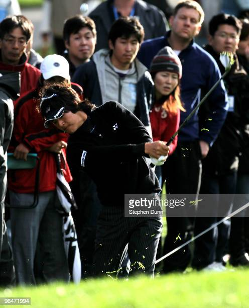 Ryo Ishikawa of Japan chips onto the 11th green during the third round of the Northern Trust Open at Riviera Country Club on February 6, 2010 in...