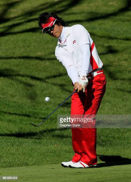 Ryo Ishikawa of Japan chips onto the green on the fourth hole during the final round of the Northern Trust Open at Riviera Country Club on February...