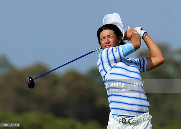 Ryo Ishikawa of Japan has his hat blown off by the wind while hitting off the 11th tee during Round Two of the 94th PGA Championship at the Ocean...
