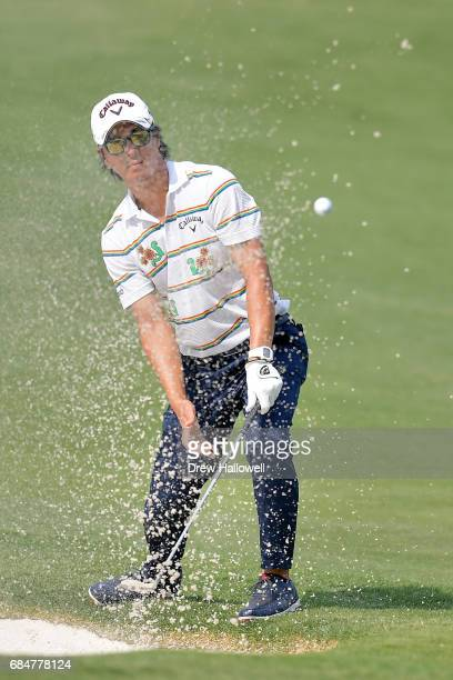 Ryo Ishikawa of Japan hits a bunker shot on the 11th hole during Round One of the ATT Byron Nelson at the TPC Four Seasons Resort Las Colinas on May...