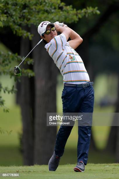 Ryo Ishikawa of Japan hits a shot on the 12th tee during Round One of the AT&T Byron Nelson at the TPC Four Seasons Resort Las Colinas on May 18,...