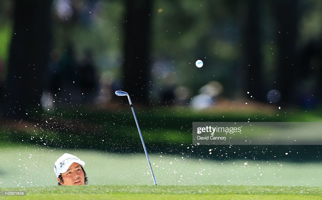 Ryo Ishikawa of Japan hits a shot out of the bunker on the 17th hole during the second round of the 2012 Masters Tournament at Augusta National Golf Club on April 6, 2012 in Augusta, Georgia.