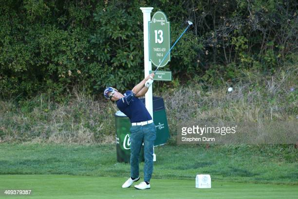 Ryo Ishikawa of Japan hits a tee shot on the 13th hole in the second round of the Northern Trust Open at the Riviera Country Club on February 14,...