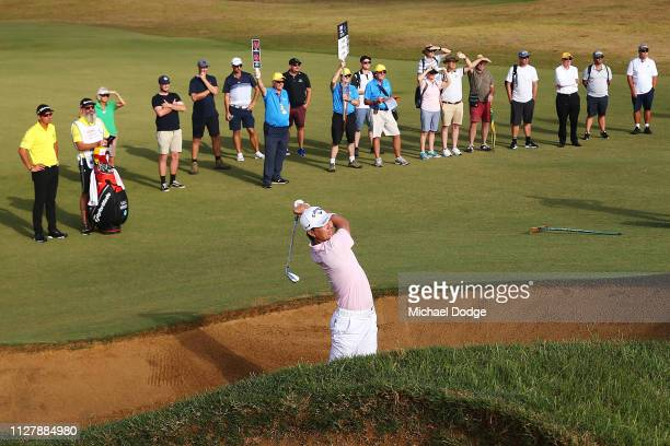 Ryo Ishikawa of Japan hits an approach shot out of the 10th fairway bunker during Day one of the ISPS Handa Vic Open at 13th Beach Golf Club on...
