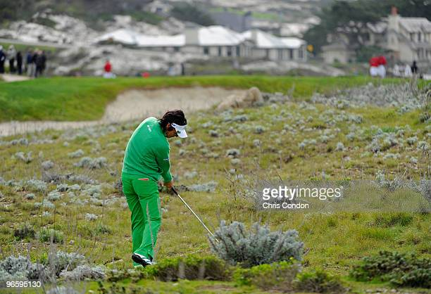 Ryo Ishikawa of Japan hits from the brush on during the first round of the ATT Pebble Beach National ProAm at Monterey Peninsula Country Club on...