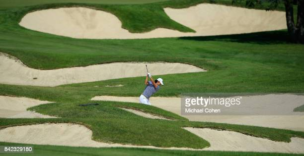 Ryo Ishikawa of Japan hits his second shot on the first hole from the fairway bunker complex during the fourth and final round of the Nationwide...