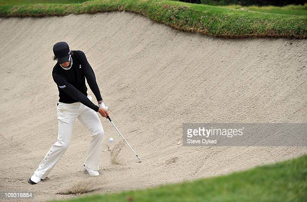 Ryo Ishikawa of Japan hits out of a sand trap on the 12th hole during the second round of the Northern Trust Open at the Riviera Country Club on...