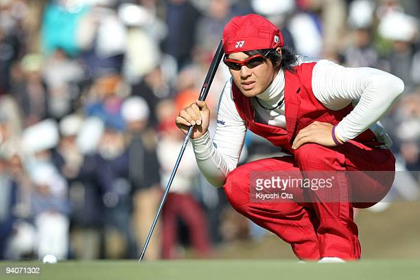 Ryo Ishikawa of Japan lines up a putt on the green of the 17th hole during the final round of the Nippon Series JT Cup at Tokyo Yomiuri Country Club...