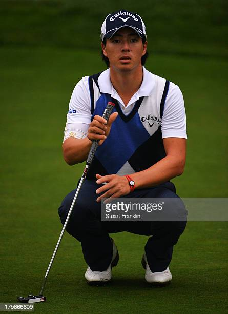 Ryo Ishikawa of Japan lines up his putt on the 13t hhole during the second round of the 95th PGA Championship on August 9, 2013 in Rochester, New...