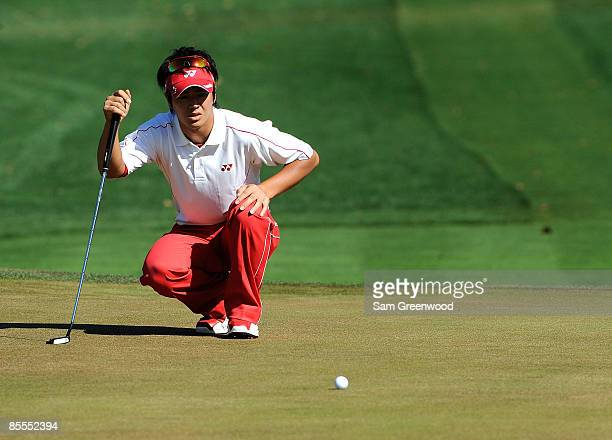 Ryo Ishikawa of Japan looks over a birdie on the eighth hole during the final round of the Transitions Championship at the Innisbrook Resort and Golf...