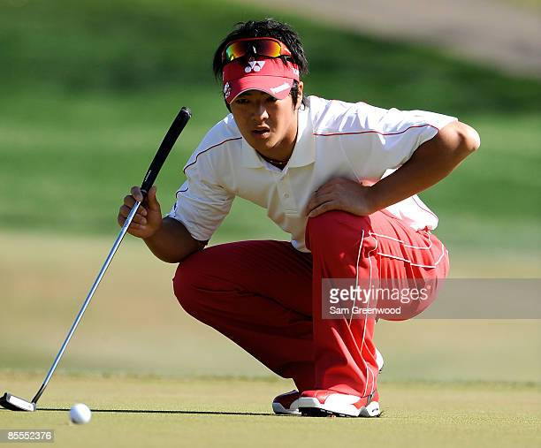Ryo Ishikawa of Japan looks over a birdie putt on the seventh hole during the final round of the Transitions Championship at the Innisbrook Resort...