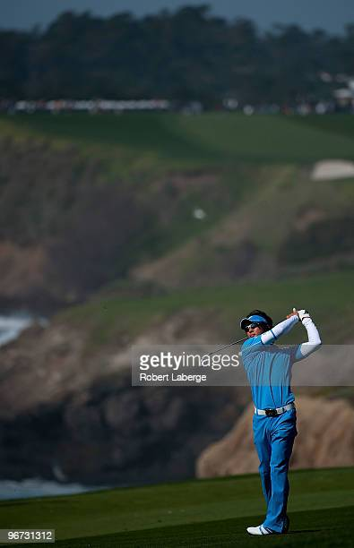 Ryo Ishikawa of Japan makes an approach shot on the tenth hole during the third round of the ATT Pebble Beach National ProAm at the Pebble Beach Golf...