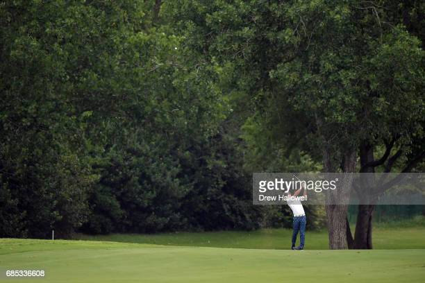 Ryo Ishikawa of Japan plays a shot on the sixth hole during Round Two of the AT&T Byron Nelson at the TPC Four Seasons Resort Las Colinas on May 19,...