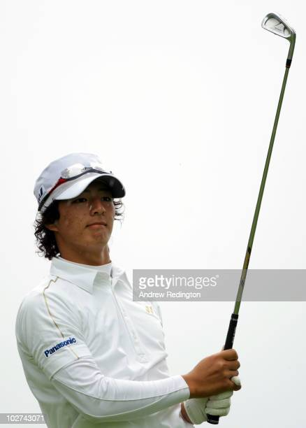 Ryo Ishikawa of Japan plays a tee shot on the eighth hole during round two of The Barclays Scottish Open at Loch Lomond Golf Club on July 9, 2010 in...