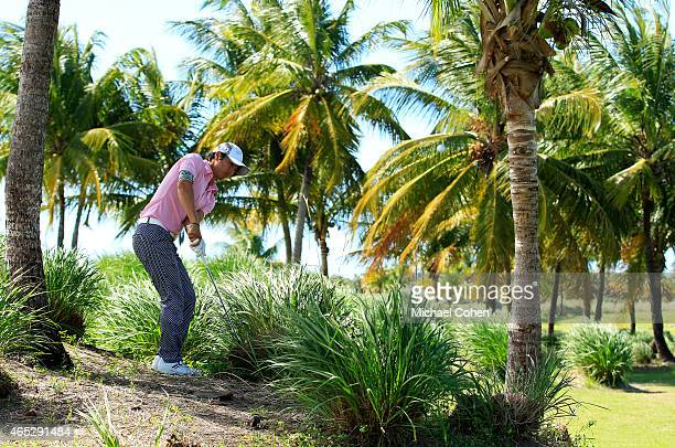 Ryo Ishikawa of Japan plays his second shot from the rough on the first hole during round one of the Puerto Rico Open presented by Banco Popular at...