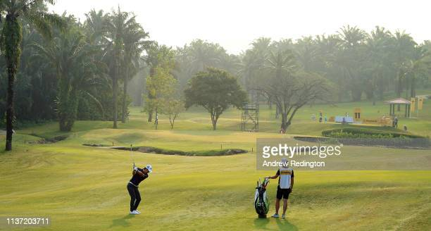 Ryo Ishikawa of Japan plays his second shot on the tenth hole on Day One of the Maybank Championship at Saujana Golf & Country Club, Palm Course on...