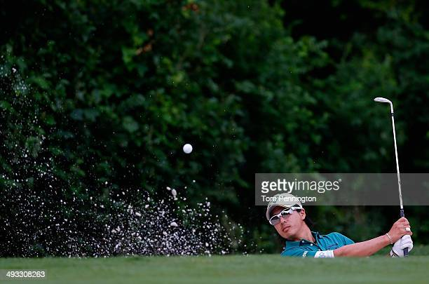 Ryo Ishikawa of Japan plays his shot out of the bunker on the 11th during Round Two of the Crowne Plaza Invitational at Colonial on May 23, 2014 at...