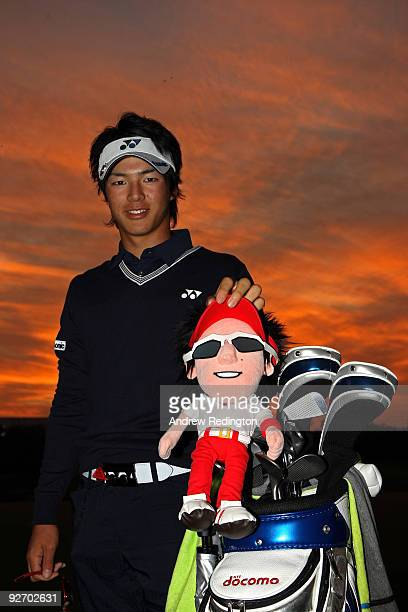 Ryo Ishikawa of Japan poses for a photograph with a headcover bearing his likeness during the pro-am prior to the start of the WGC-HSBC Champions at...