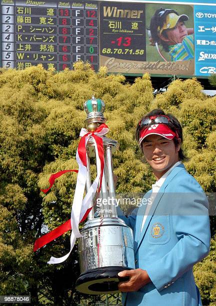 Ryo Ishikawa of Japan poses for photographs with the trophy after winning The 51st Chunichi Crowns at Nagoya Golf Club on April 29, 2010 in Togo,...