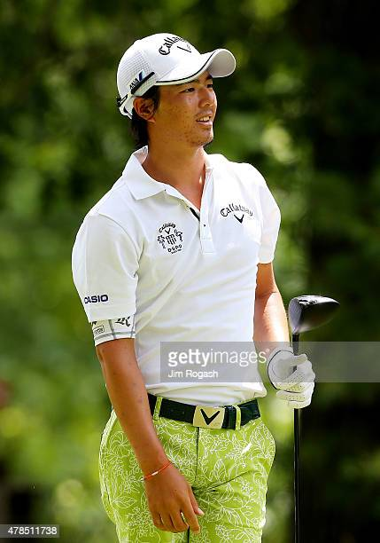Ryo Ishikawa of Japan reacts after playing his shot from the fourth tee during the first round of the Travelers Championship at TPC River Highlands...
