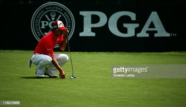 Ryo Ishikawa of Japan waits on the first green during the final round of the 95th PGA Championship at Oak Hill Country Club on August 11, 2013 in...