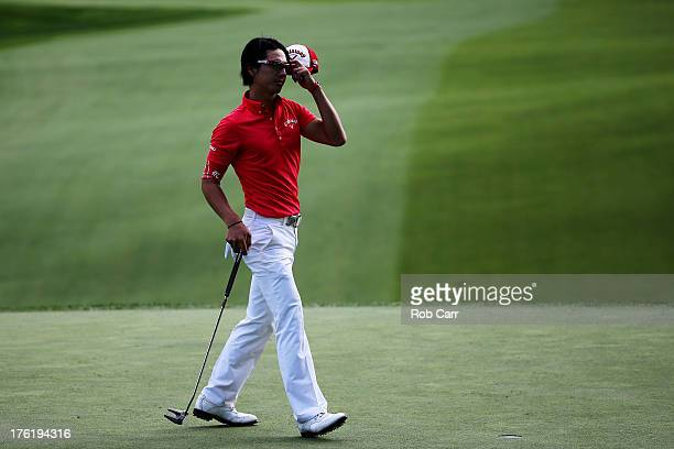 Ryo Ishikawa of Japan walks off the 18th green after a two-over par 72 during the final round of the 95th PGA Championship at Oak Hill Country Club...