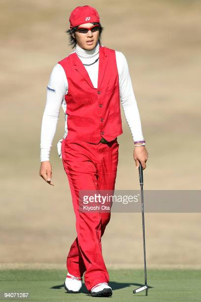 Ryo Ishikawa of Japan walks on the green during the final round of the Nippon Series JT Cup at Tokyo Yomiuri Country Club on December 6, 2009 in...