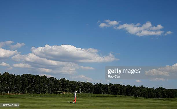 Ryo Ishikawa of Japan walks to the 13th green during the second round of the Quicken Loans National at the Robert Trent Jones Golf Club on July 31...