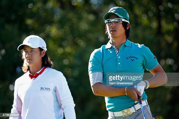 Ryo Ishikawa of Japan watches his tee shot on the 6th hole as Richard Lee looks on during the second round of the Valspar Championship at Innisbrook...