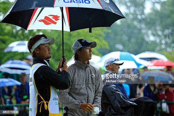 Ryo Ishikawa of Japan with his caddie Yoshi Sato before teeing off on the first hole during the third round of the John Deere Classic held at TPC...