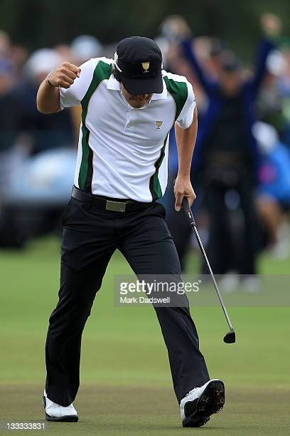 Ryo Ishikawa of the International Team celebrates making a putt on the 17th hole during the Day Three Morning Foursome Matches of the 2011 Presidents...
