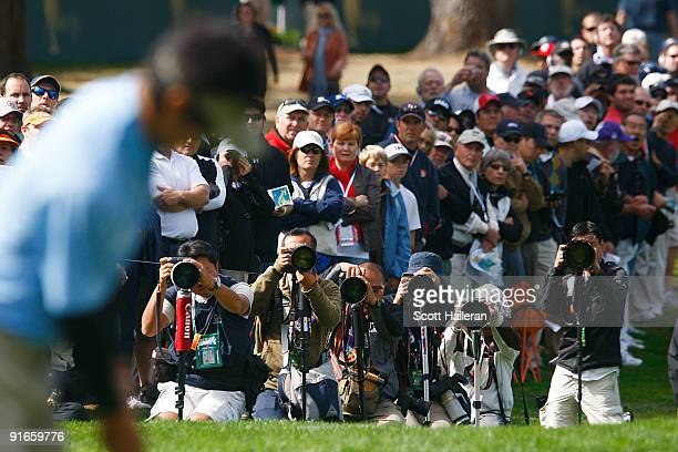 Ryo Ishikawa of the International Team is photographed as he lines up a putt on the first green during the Day Two Fourball Matches of The Presidents...