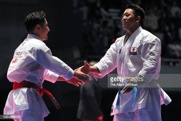 Ryo Kiyuna and Kazumasa Moto of Japan embrace after competing in the Men's Kata final during the Karate1 Premier League Tokyo at Tokyo Budoan on...