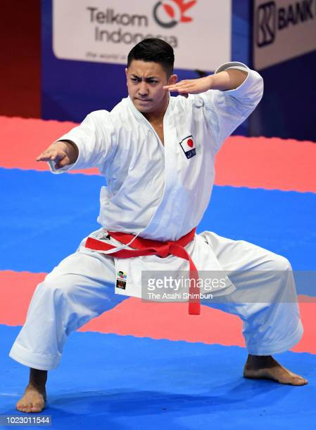 Ryo Kiyuna of Japan competes against Wang Tiya of Taiwan in the Karate Men's Kata final at the Jakarta Convention Center on day seven of the Asian...