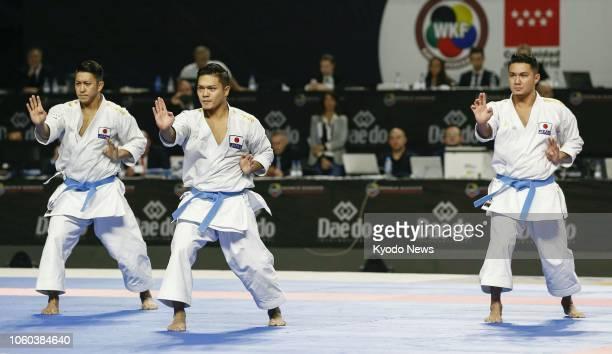 Ryo Kiyuna, Takuya Uemura and Arata Kinjo of Japan perform in the final of the men's karate kata team competition at the world championships in...