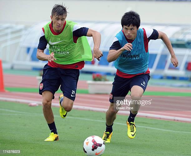 Ryo Miyaichi and Kris Olsson of Arsenal FC in Japan for the club's preseason Asian tour at the Urawa Komaba Stadium on July 25 2013 in Saitama Japan