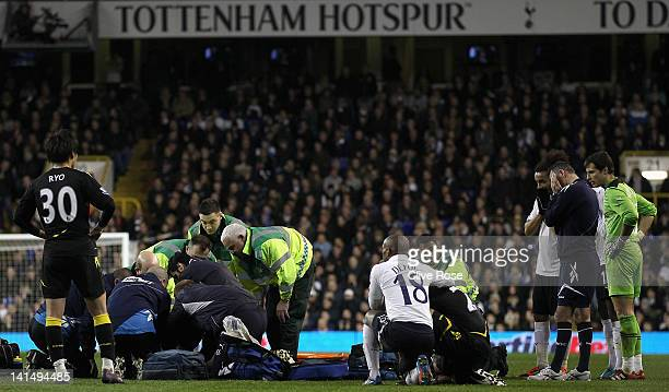 Ryo Miyaichi and manager Owen Coyle of Bolton Wanderers look on distraught with other players as Fabrice Muamba of Bolton Wanderers receives CPR...