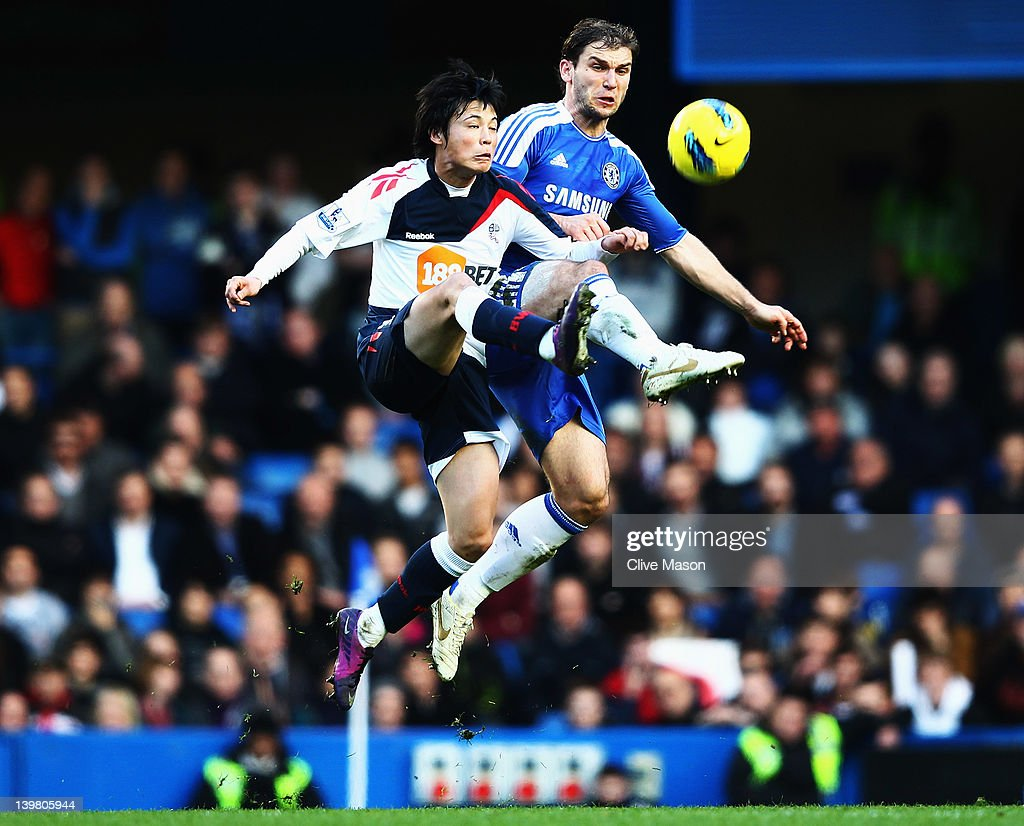 Ryo Miyaichi (L) of Bolton Wanderers and Branislav Ivanovic (R) of Chelsea in action during the Barclays Premier League match between Chelsea and Bolton Wanderers at Stamford Bridge on February 25, 2012 in London, England.