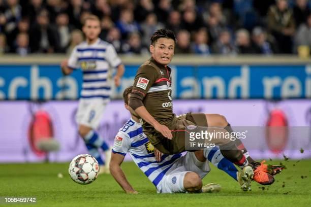 Ryo Miyaichi of St Pauli battle for the ball during the Second Bundesliga match between MSV Duisburg and FC St Pauli at SchauinslandReisenArena on...