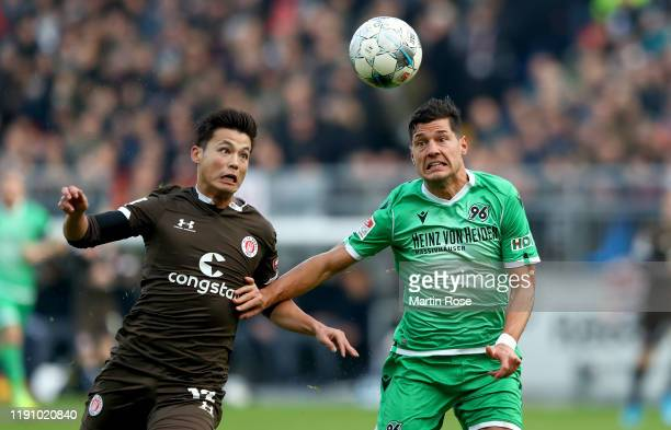 Ryo Miyaichi of St Pauli challenges Miiko Albornoz of Hannover during the Second Bundesliga match between FC St Pauli and Hannover 96 at Millerntor...