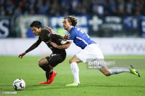 Ryo Miyaichi of St Pauli is challenged by Yannick Stark of Darmstadt during the Second Bundesliga match between SV Darmstadt 98 and FC St Pauli at...