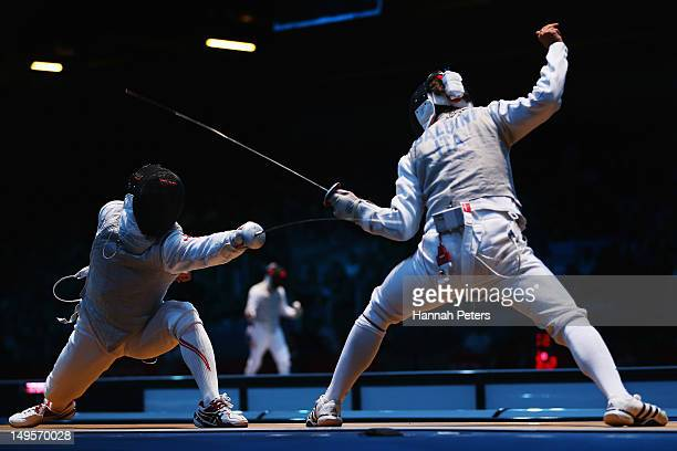 Ryo Miyake of Japan competes against Andrea Baldini of Italy during the round of 32 Men's Foil Individual on Day 4 of the London 2012 Olympic Games...