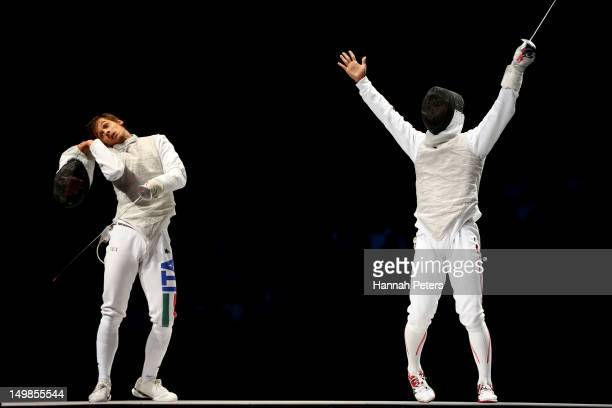 Ryo Miyake of Japan reacts while competing against Andrea Baldini of Italy in the gold medal match of the Men's Foil Team Fencing finals on Day 9 of...
