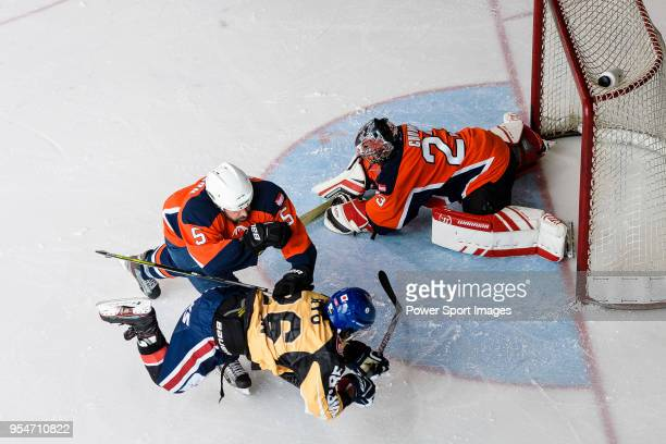 Ryo Miyazaki of Empire Skate battle in the goal mouth with Thomas Sorensen of Singapore Hawkers during the Mega Ice Hockey 5s match between Singapore...