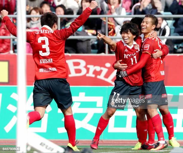 Ryo Nagai of Nagoya Grampus celebrates scoring the opening goal with his team mate Hisato Sato and Kazuki Kushibiki during the J.League J2 match...