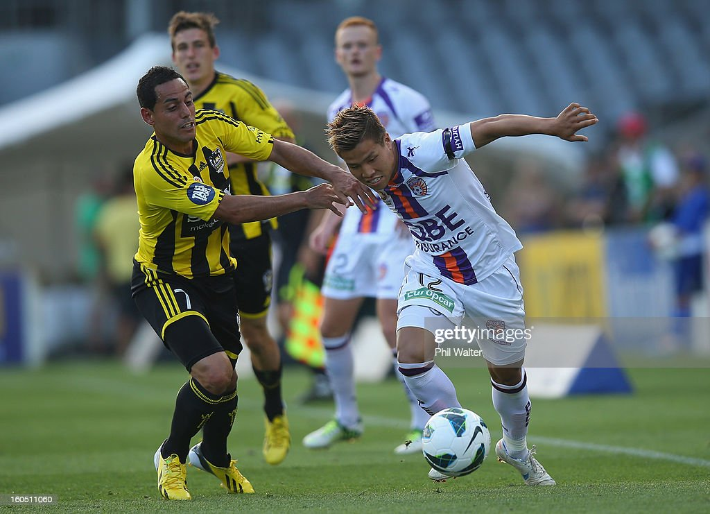 Ryo Nagai of Perth is tackled by Leo Bertos of the Phoenix during the round 19 A-League match between the Wellington Phoenix and the Perth Glory at Eden Park on February 2, 2013 in Auckland, New Zealand.