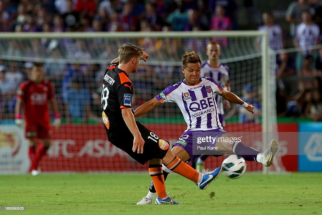 Ryo Nagai (R) of the Glory attempts block a pass by Luke Brattan of the Roar during the round 18 A-League match between the Perth Glory and the Brisbane Roar at nib Stadium on January 26, 2013 in Perth, Australia.
