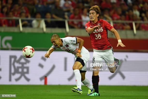 Ryo Okui of Omiya Ardija and Daisuke Kikuchi of Urawa Red Diamonds compete for the ball during the J.League J1 match between Urawa Red Diamonds and...